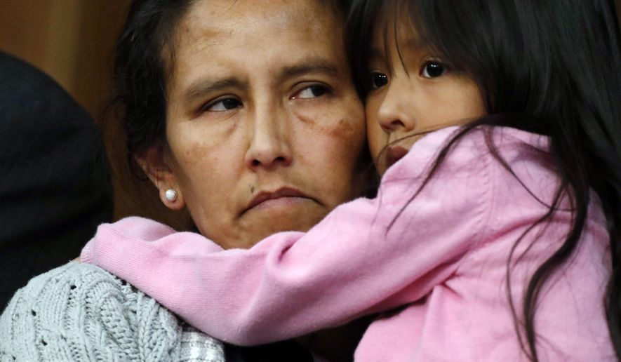 Jeanette Vizguerra, left, a Mexican woman seeking to avoid deportation from the United States, cradles her 6-year-old daughter, Zuri, during a news conference in a church in which she and her children have taken refuge, Wednesday, Feb. 15, 2017, in Denver. U.S. immigration authorities have denied the her request to remain in the country. (AP Photo/David Zalubowski)