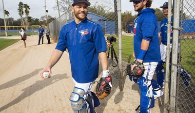 Toronto Blue Jays catchers Russell Martin, left, and Jarrod Saltalamacchia, right, laugh during baseball spring training in Dunedin, Fla., Wednesday, Feb 15, 2017. (Nathan Denette/The Canadian Press via AP)