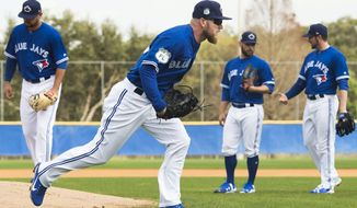 Toronto Blue Jays pitcher J.P. Howell, front, takes part in a drill during baseball spring training in Dunedin, Fla.., Wednesday, February 15, 2017.(Nathan Denette/The Canadian Press via AP)