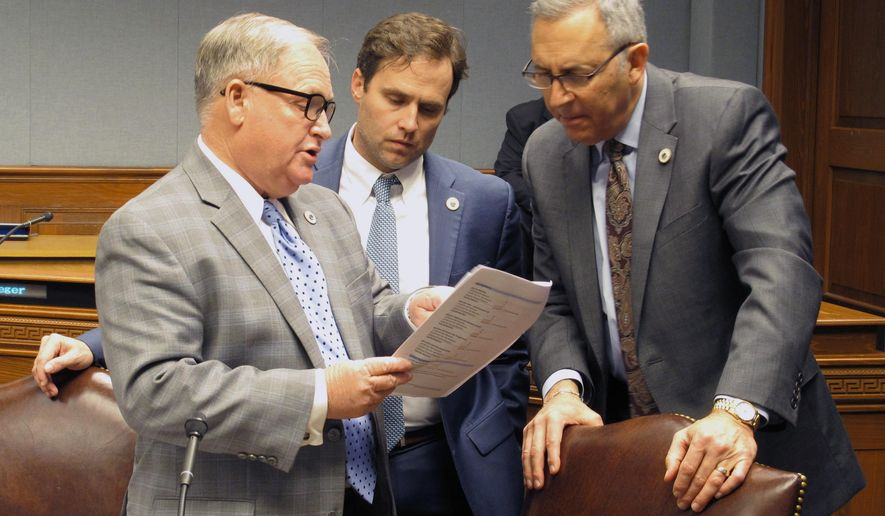 From left, Reps. Rick Edmonds, R-Baton Rouge; Tanner Magee, R-Houma; and Mark Abraham, R-Lake Charles, talk about budget cut proposals ahead of the House Appropriations Committee meeting, on Wednesday, Feb. 15, 2017, in Baton Rouge, La. (AP Photo/Melinda Deslatte)