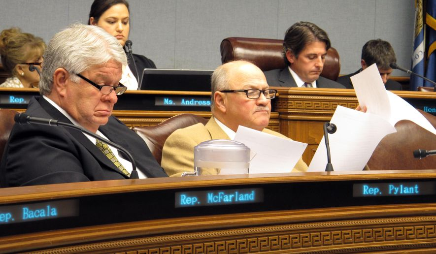 Reps. Steve Pylant, from left, R-Winnsboro, and Johnny Berthelot, R-Gonzales, look at a budget cut proposal during the House Appropriations Committee meeting, Wednesday, Feb. 15, 2017, in Baton Rouge, La. (AP Photo/Melinda Deslatte)