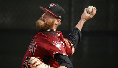 Arizona Diamondbacks pitcher Archie Bradley throws  during baseball spring training Tuesday, Feb. 14, 2017, in Scottsdale, Ariz. (Rob Schumacher/The Arizona Republic via AP)