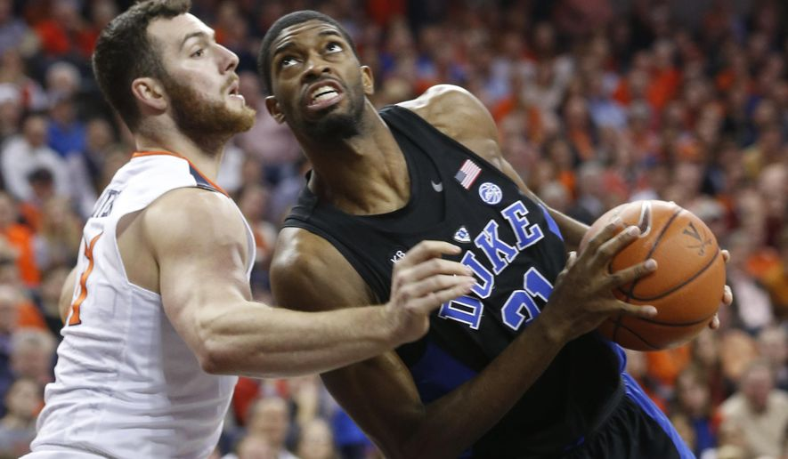 Duke forward Amile Jefferson, right, drives to the basket as Virginia forward Jarred Reuter defends during the first half of an NCAA college basketball game in Charlottesville, Va., Wednesday, Feb. 15, 2017. (AP Photo/Steve Helber)