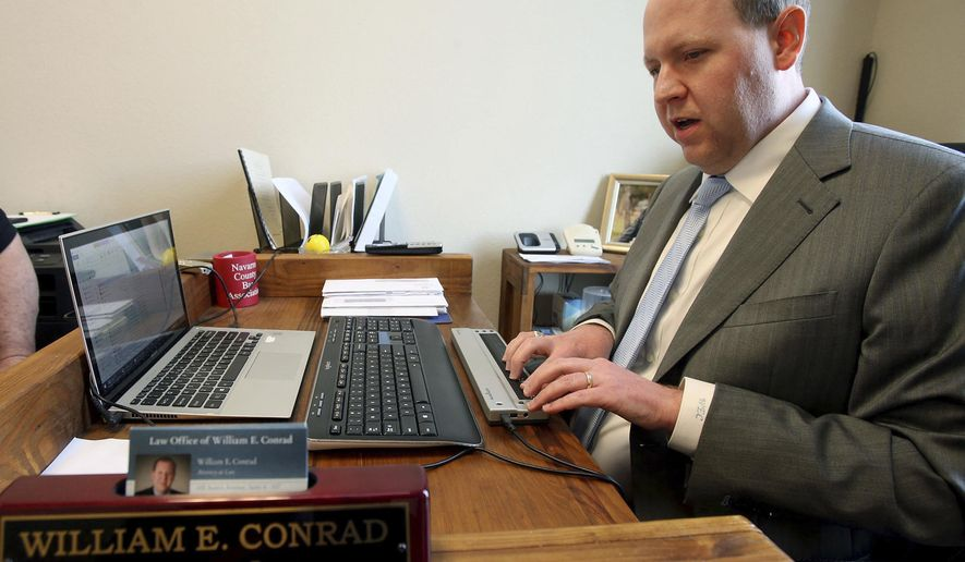 ADVANCE FOR USE MONDAY, FEB. 20 - In this Wednesday, Feb. 8, 2017 photo, attorney Will Conrad types on a special key board at his office in Waco, Texas. People who know the 34-year-old Dallas native and view the relative ease he gets around the courtroom say they tend to forget Conrad is blind. (Jerry Larson/Waco Tribune-Herald via AP)
