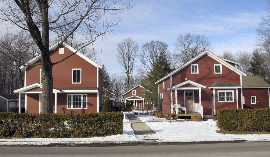 This Feb. 2, 2017 photo shows some of the houses purchased by the Burlington International Airport in South Burlington, Vt., due to aircraft noise. The airport has offered a voluntary program to buy more than three dozen homes two years before F-35 military jets will be arriving at to replace the Air National Guard's aging F-16s. (AP Photo/Lisa Rathke)