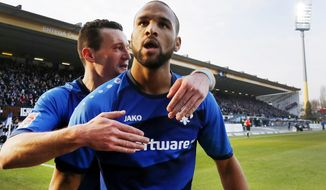 Darmstadt's Terrence Boyd celebrates his side's opening goal during a German first division Bundesliga soccer match between SV Darmstadt 98 and Borussia Dortmund in Darmstadt, Germany, Saturday, Feb. 11, 2017.(AP Photo/Michael Probst)