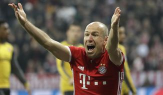 Bayern's Arjen Robben gestures as he questions a referee call during the Champions League round of 16 first leg soccer match between FC Bayern Munich and Arsenal, in Munich, Germany, Wednesday, Feb. 15, 2017. (AP Photo/Matthias Schrader)