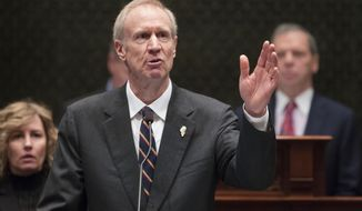 FILE - In this Jan. 25, 2017, file photo, Illinois Gov. Bruce Rauner delivers his State of the State address in the Illinois House chamber in Springfield, Ill. Rauner will propose a third annual budget that is likely to be shelved by the Legislature like his first two, as he addresses a joint session of the Legislature on Wednesday, Feb. 15. (Ted Schurter/The State Journal-Register via AP, File)