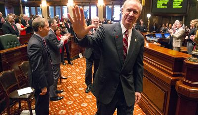Illinois Gov. Bruce Rauner acknowledges Republican lawmakers as he approaches the dais to deliver his budget address to a joint session of the General Assembly at the Capitol Wednesday, Feb. 15, 2017, in Springfield, Ill. (Rich Saal/The State Journal-Register via AP)