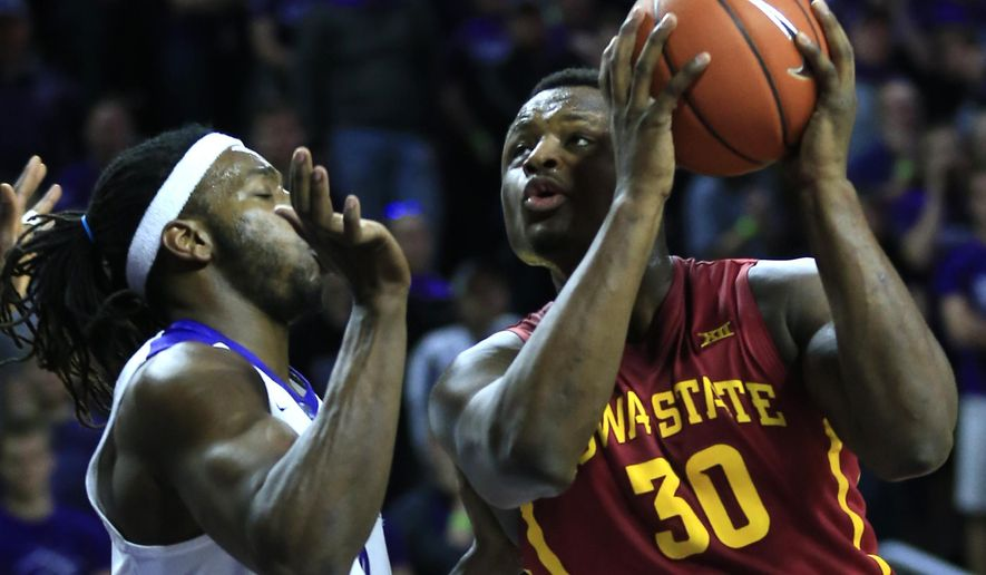 Iowa State guard Deonte Burton (30) drives on Kansas State forward D.J. Johnson (4) during the first half of an NCAA college basketball game in Manhattan, Kan., Wednesday, Feb. 15, 2017. (AP Photo/Orlin Wagner)