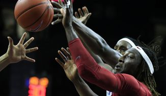Iowa State forward Solomon Young, front, rebounds against Kansas State forward D.J. Johnson, back, during the second half of an NCAA college basketball game in Manhattan, Kan., Wednesday, Feb. 15, 2017. (AP Photo/Orlin Wagner)