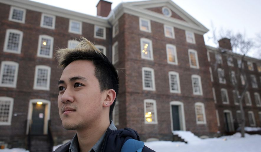 In this Tuesday, Feb. 14, 2017 photo Brown University senior Viet Nguyen stands for a portrait on the schools campus, in Providence, R.I. Ivy League students are asking their schools to automatically waive the application fee for applicants who are low-income or the first in their families to attend college. Nguyen, who leads the undergraduate student government, is asking student government leaders and student groups at other universities to sign on. (AP Photo/Steven Senne)