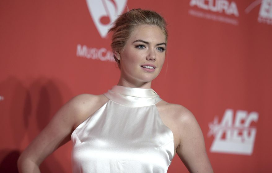 In this Friday, Feb. 10, 2017, file photo, Kate Upton arrives at the MusiCares Person of the Year tribute honoring Tom Petty at the Los Angeles Convention Center. She's once, twice, three times a Sports Illustrated swimsuit cover lady. Upton once again graces the cover of the annual issue, becoming only the fourth woman to ever do it three times. This year, she makes the splash with three different covers. (Photo by Richard Shotwell/Invision/AP, File)