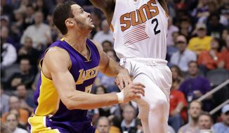 Phoenix Suns guard Eric Bledsoe (2) shoots over Los Angeles Lakers forward Larry Nance Jr. during the second half of an NBA basketball game, Wednesday, Feb. 15, 2017, in Phoenix. (AP Photo/Matt York)