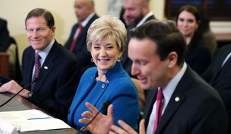 FILE - In this Jan. 24, 2017 file photo, Sen. Chris Murphy, D-Conn., right, introduces former wrestling entertainment executive Linda McMahon, center, at her confirmation hearing before the Senate Small Business and Entrepreneurship Committee on Capitol Hill in Washington. At left is Sen. Richard Blumenthal, D-Conn. The two senators she competed against in previous bitter campaigns and Democratic Gov. Dannel P. Malloy are complementing McMahon, the new administrator of the Small Business Administration, sworn in Tuesday, Feb. 14, 2017. (AP Photo/Alex Brandon, File )