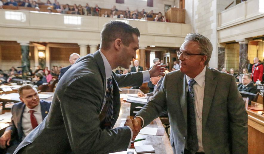 In this Jan. 4, 2017 photo, Neb. state Sen. Tyson Larson of O'Neill, left, congratulates Sen. Jim Scheer of Norfolk upon being elected as Speaker of the Unicameral, in Lincoln, Neb. Thirty days after they convened, Nebraska lawmakers are still spinning their wheels over parliamentary rules in what's shaping up to be one of the least productive legislative sessions in state history. Lawmakers on Wednesday, Feb. 15 will have burned through one-third of the days available for debate but have only passed two bills so far. (AP Photo/Nati Harnik)