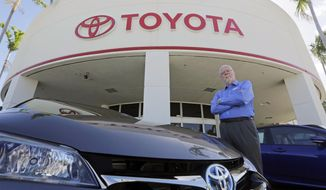 In this Friday, Feb. 10, 2017, file photo, Earl Stewart, owner of a Toyota dealership, poses for a photo at his business in North Palm Beach, Fla. (AP Photo/Alan Diaz)