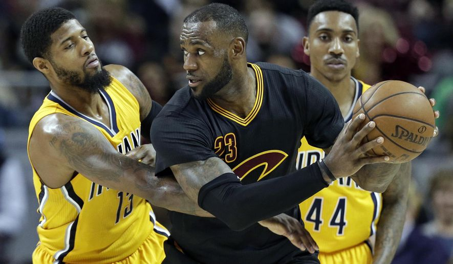 Cleveland Cavaliers' LeBron James (23) tries to get past Indiana Pacers' Paul George (13) in the second half of an NBA basketball game, Wednesday, Feb. 15, 2017, in Cleveland. The Cavaliers won 113-104. (AP Photo/Tony Dejak)