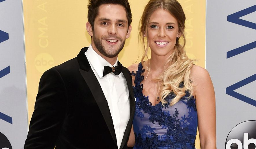 FILE - This Nov. 2, 2016 file photo shows Thomas Rhett and his wife Lauren at the 50th annual CMA Awards in Nashville, Tenn. Rhett announced on Twitter Wednesday, Feb. 15, 2017, that his wife is pregnant and that they are also in the process of adopting a child from Africa. (Photo by Evan Agostini/Invision/AP, File)