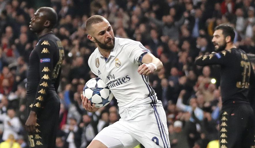 Real Madrid's Karim Benzema celebrates after scoring his side's first goal during the Champions League round of 16, first leg, soccer match between Real Madrid and Napoli at the Santiago Bernabeu stadium in Madrid, Wednesday Feb. 15, 2017. (AP Photo/Daniel Ochoa de Olza)