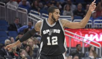 San Antonio Spurs forward LaMarcus Aldridge (12) celebrates after scoring during the first half of the team's NBA basketball game against the Orlando Magic in Orlando, Fla., Wednesday, Feb. 15, 2017. (AP Photo/Phelan M. Ebenhack)