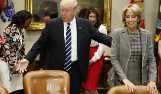 President Donald Trump arrives for a meeting with Education Secretary Betsy Devos and parents and teachers, Tuesday, Feb. 14, 2017, in the Roosevelt Room of the White House in Washington. (AP Photo/Evan Vucci)