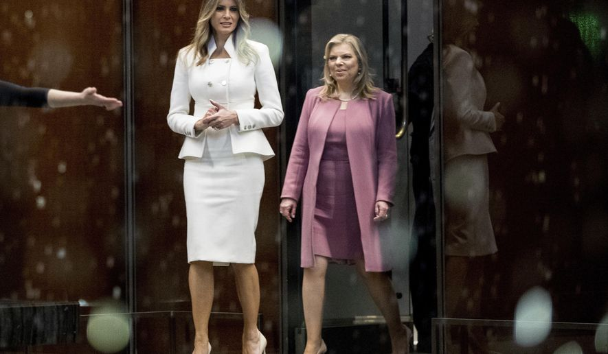 First lady Melania Trump and Sara Netanyahu, wife of Israeli Prime Minister Benjamin Netanyahu, walk into the contemplative court during a tour of the Smithsonian's National Museum of African American History and Culture in Washington, Wednesday, Feb. 15, 2017. (AP Photo/Andrew Harnik)