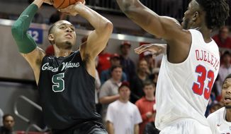 Tulane guard Cameron Reynolds (5) attempts a shot over SMU's Semi Ojeleye (33) in the half of an NCAA college basketball game, Wednesday, Feb. 15, 2017, in Dallas. (AP Photo/Tony Gutierrez)
