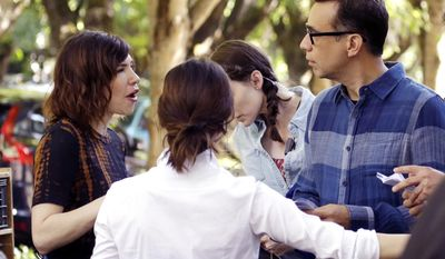"This Sept. 18, 2015 photo shows Fred Armisen, right, with co-star Carrie Brownstein, left, during the filming of their series, ""Portlandia,"" in Portland, Ore. Brownstein and Armisen conceived the series with fellow executive producer Jonathan Krisel, and the two of them play various and sundry characters.(AP Photo/Don Ryan)"