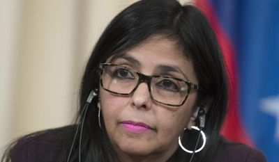"""FILE - In this Feb. 6, 2017 file photo, Venezuela's Foreign Minister Delcy Rodriguez attends a news conference in Moscow, Russia. Venezuela suspended CNN in Spanish on Wednesday, Feb. 15, 2017, shutting off the news channel a few hours after officials angrily criticized a report saying government workers engaged in selling fraudulent passports. Rodriguez said President Nicolas Maduro's government had requested that authorities take action against CNN in Spanish because of the """"damage"""" it caused Venezuela. (AP Photo/Pavel Golovkin, File)"""