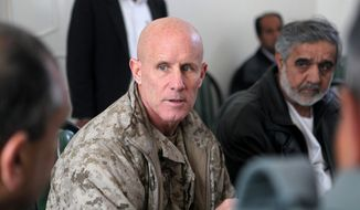Vice Adm. Robert S. Harward, commanding officer of Combined Joint Interagency Task Force 435, speaks to an Afghan official during his visit to Zaranj, Afghanistan, Jan 6. The visit consisted of a tour of a provincial prison, the Iran/Afghanistan border crossing and an airfield assessment.