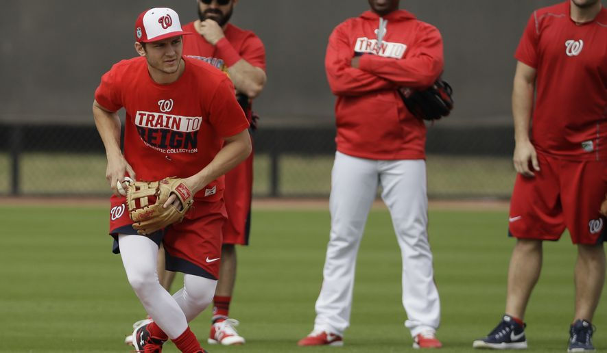 Washington Nationals shortstop Trea Turner fields a ground ball during a spring training baseball workout Thursday, Feb. 16, 2017, in West Palm Beach, Fla. (AP Photo/David J. Phillip)
