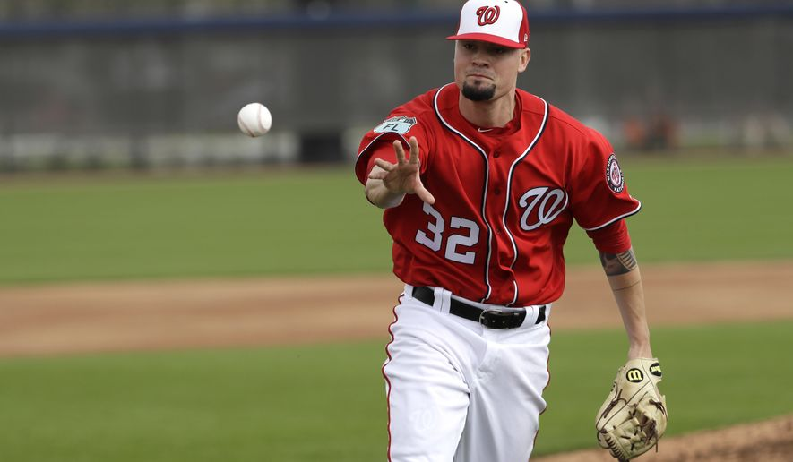 Washington Nationals relief pitcher Koda Glover tosses the ball to home during a spring training baseball workout Thursday, Feb. 16, 2017, in West Palm Beach, Fla. (AP Photo/David J. Phillip)