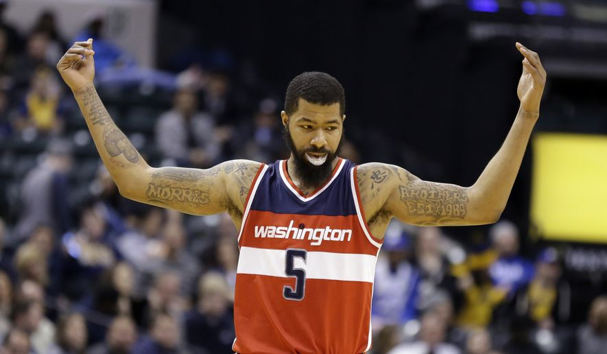Washington Wizards forward Markieff Morris (5) celebrates in the final minute of the second half of an NBA basketball game against the Indiana Pacers in Indianapolis, Thursday, Feb. 16, 2017. (AP Photo/Michael Conroy) **FILE**