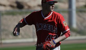 Los Angeles Angels starting pitcher Garrett Richards looks to throw during spring baseball practice in Tempe, Ariz., Wednesday, Feb. 15, 2017. (AP Photo/Chris Carlson)