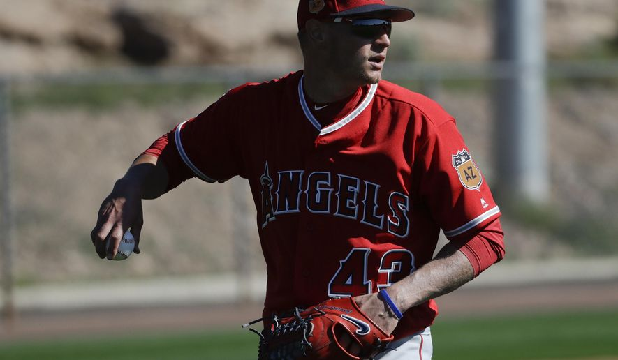 Los Angeles Angels starting pitcher Garrett Richards looks to throw during spring baseball practice in Tempe, Ariz., Wednesday, Feb. 15, 2017. (AP Photo/Chris Carlson)