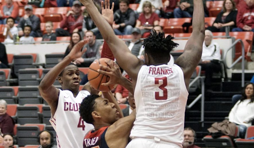 Arizona forward Allonzo Trier (35) tries to shoot between Washington State defenders Viont'e Daniels (4) and Robert Franks (3) in the first half of an NCAA college basketball game, Thursday, Feb. 16, 2017, in Pullman, Wash. (AP Photo/Kai Eiselein)