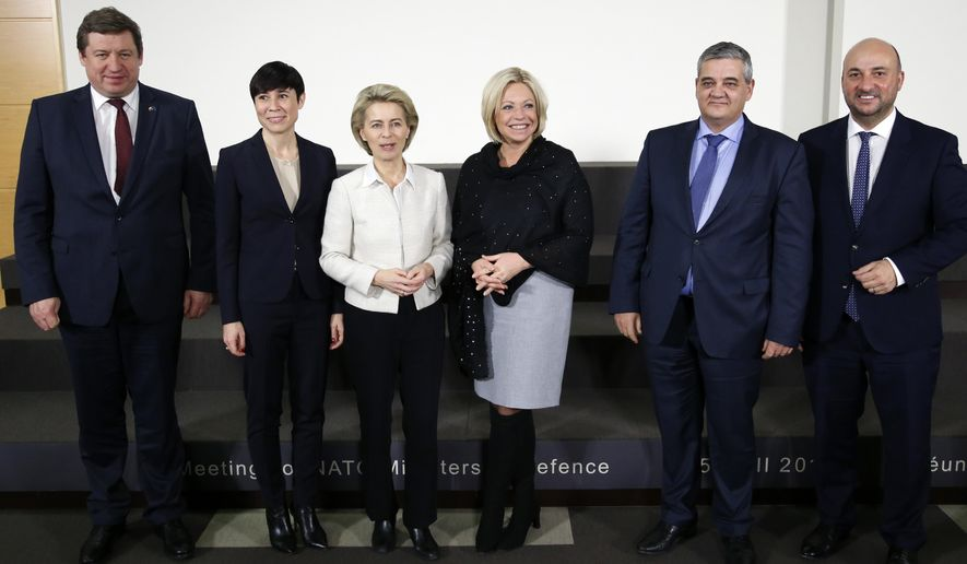 From left, Lithuania's Defense Minister Raimundas Karoblis, Norway's Defense Minister Ine Marie Eriksen Soreide, German Defense Minister Ursula von der Leyen, Dutch Defense Minister Jeanine Hennis-Plasschaert, Belgium's Defense Minister Steven Vandeput and Luxembourg's Defense Minister Etienne Schneider pose before signing a european military cooperation agreements at NATO headquarters in Brussels, on Thursday, Feb. 16, 2017. (Francois Lenoir, Pool Photo via AP)