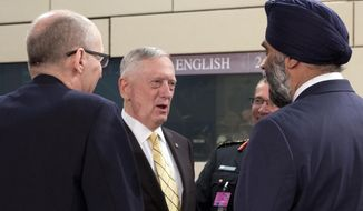 """U.S. Secretary of Defense Jim Mattis, center, speaks with Canadian Defense Minister Harjit Singh Sajjan, right, during a meeting of the NATO-Georgia Council at NATO headquarters in Brussels on Thursday, Feb. 16, 2017. U.S. Defense Secretary Jim Mattis on Wednesday told NATO ministers that the alliance is """"a fundamental bedrock for the United States"""" while at the same time demanding an increased financial commitment from the 27 other alliance members. (AP Photo/Virginia Mayo)"""