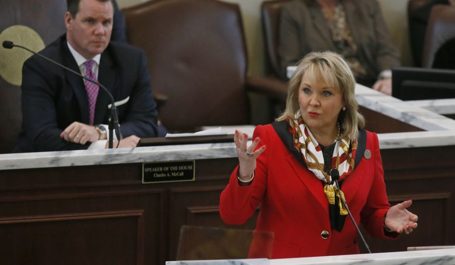 In this Monday, Feb. 6, 2017 photo, Oklahoma Lt. Gov. Todd Lamb, left, listens as Oklahoma Gov. Mary Fallin, right, delivers her State of the State address in Oklahoma City. Lamb, a likely candidate for governor in 2018, has resigned from his position on Gov. Mary Fallin's cabinet, citing a disagreement with Fallin over her plans to broaden the sales tax to a variety of services. (AP Photo/Sue Ogrocki)