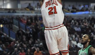 Chicago Bulls' Jimmy Butler (21) dunks against Boston Celtics' Jae Crowder (99) during the first half of an NBA basketball game Thursday, Feb. 16, 2017, in Chicago. (AP Photo/Paul Beaty)