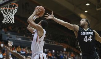 Oregon State's Kendal Manuel, left, goes to the basket past Colorado's Josh Fortune (44) during the first half of an NCAA college basketball game in Corvallis, Ore., Thursday, Feb. 16, 2017. (AP Photo/Timothy J. Gonzalez)