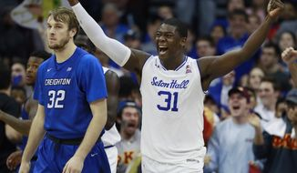 Seton Hall forward Angel Delgado (31) reacts after a call as Creighton forward Toby Hegner (32) walks away during the second half of an NCAA college basketball game, Wednesday, Feb. 15, 2017, in Newark, N.J. Seton Hall won 87-81. (AP Photo/Julio Cortez)