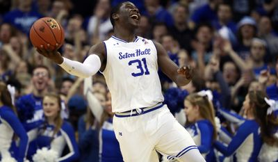 Seton Hall forward Angel Delgado celebrates after his team beat Creighton 87-81 in an NCAA college basketball game, Wednesday, Feb. 15, 2017, in Newark, N.J. (AP Photo/Julio Cortez)
