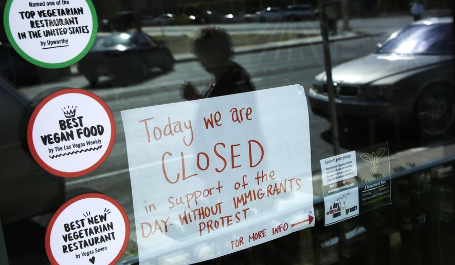 A sign alerts customers that restaurant VegeNation is closed in support of the Day Without Immigrants protest, Thursday, Feb. 16, 2017, in Las Vegas. Immigrants around the U.S. stayed home from work and school Thursday to demonstrate how important they are to America's economy and its way of life, and many businesses closed in solidarity, in a nationwide protest called A Day Without Immigrants. (AP Photo/John Locher)