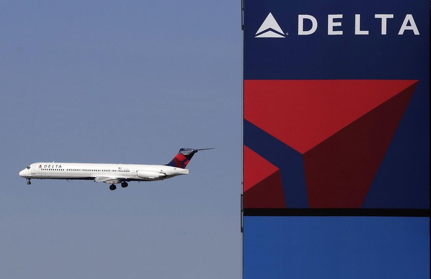 FILE - In this Saturday, April 6, 2013 file photo, a Delta Airlines jet flies past the company's billboard at Citi Field, in New York. Delta says Thursday, Feb. 16, 2017 that it will start serving meals to all passengers on 12 long-haul routes over the next several weeks. Airlines took away free sandwiches and similar fare after an industry downturn during the worldwide financial crisis.  (AP Photo/Mark Lennihan)