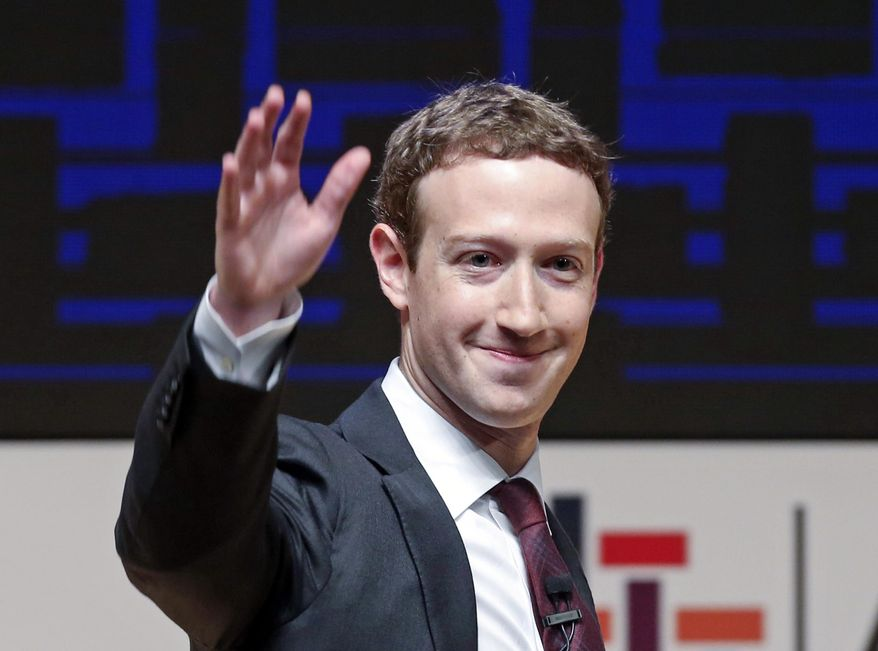 Mark Zuckerberg, chairman and CEO of Facebook, waves at the CEO summit during the annual Asia Pacific Economic Cooperation (APEC) forum in Lima, Peru, in this Nov. 19, 2016, file photo. Zuckerberg released a missive Thursday, Feb. 16, 2017, outlining his vision for the social network and the world at large. Among other things, Zuckerberg hopes that the social network can encourage more civic engagement, an informed public and community support in the years to come. (AP Photo/Esteban Felix, File)