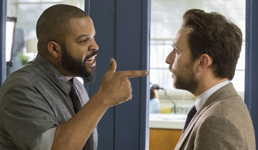 """This image released by Warner Bros. Pictures shows Ice Cube, left, and Charlie Day in a scene from """"Fist Fight."""" (Bob Mahoney/Warner Bros. Pictures via AP) ** FILE **"""