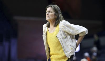 Virginia coach Joanne Boyle watches during the first half of the team's NCAA college basketball game against Florida State on Thursday, Feb. 16, 2017. in Charlottesville, Va. (AP Photo/Ryan M. Kelly)