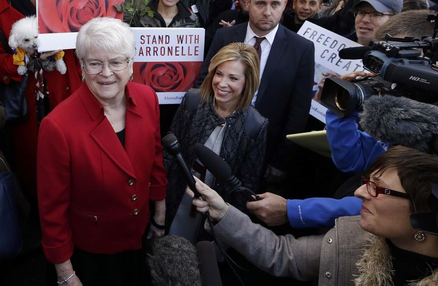 FILE - In this Nov. 15, 2016, file photo, Barronelle Stutzman, left, a Richland, Wash., florist who was fined for denying service to a gay couple in 2013, smiles as she is surrounded by supporters after a hearing before Washington's Supreme Court in Bellevue, Wash. The Washington Supreme Court on Thursday, Feb. 16, 2017, has unanimously ruled that Stutzman broke the state's antidiscrimination law.  Stutzman said she was exercising her First Amendment rights, and her lawyers immediately said they would ask the U.S. Supreme Court to overturn the decision. (AP Photo/Elaine Thompson, File)